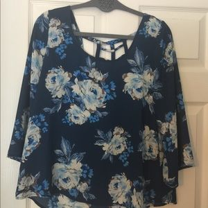 Tops - Blue floral blouse with back web accent